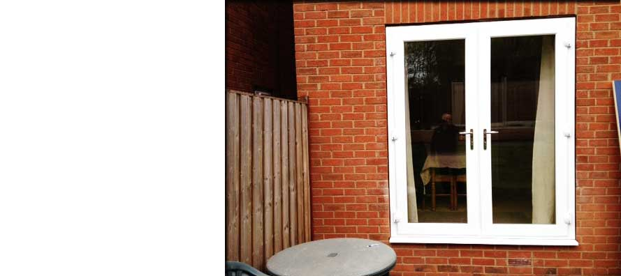 simple white french double glazed doors