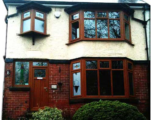 crisp white double glazing windows installed in a 2 story brick sheffield home
